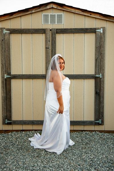 gorgeous bride sunset barn wedding photo