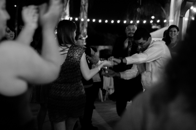 photography by paulina outdoor fall wedding reception string lights black and white photo